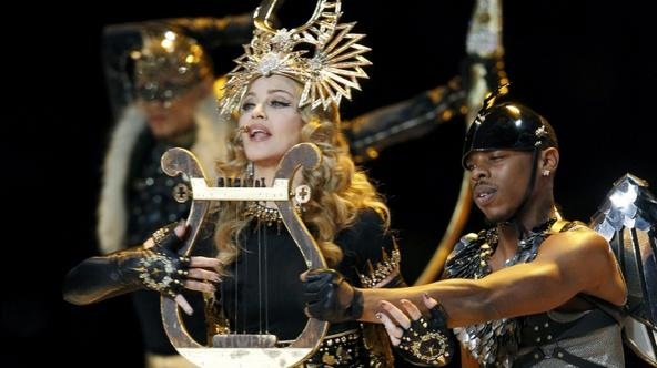 'Madonna performs during the halftime show in the NFL Super Bowl XLVI football game in Indianapolis, Indiana, February 5, 2012. REUTERS/Mike Segar (UNITED STATES  - Tags: SPORT FOOTBALL)'