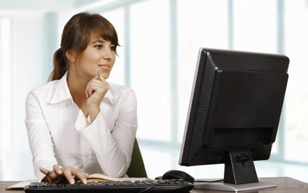 'Young woman working with computer'