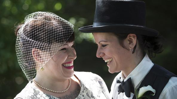 Michelle Brand, May BrandMichelle, left, and May Brand laugh before joining over 100 gay couples in a mass wedding during World Pride 2014 at Casa Loma in Toronto, on Thursday, June 26, 2014. THE CANADIAN PRESS/Darren CalabreseDarren Calabrese Photo: Pres