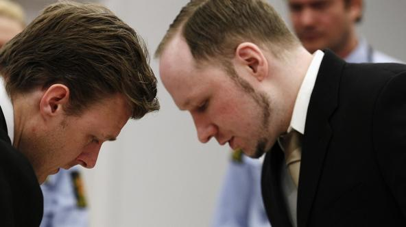 'Norwegian mass killer Anders Behring Breivik (R) confers with Tord Jordet, a member of his defence team, in courtroom 250 during the second day of his terrorism and murder trial in Oslo April 17, 201