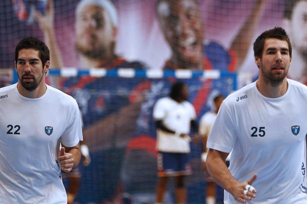 'Montpellier\'s Nikola Karabatic (L) warms-up with his brother and teammate Luka before their team\'s Ligue 1 handball match against Paris Saint Germain in Paris, September 30, 2012. French handball c