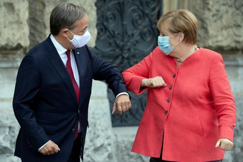 FILE PHOTO: German Chancellor Merkel meets Armin Laschet in Duesseldorf