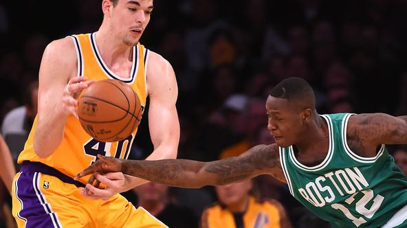 NBA: Boston Celtics at Los Angeles Lakers Mar 3, 2017; Los Angeles, CA, USA; Boston Celtics guard Terry Rozier (12) knocks the ball from the hands of Los Angeles Lakers center Ivica Zubac (40) in the second half of the game at Staples Center. The Celtics