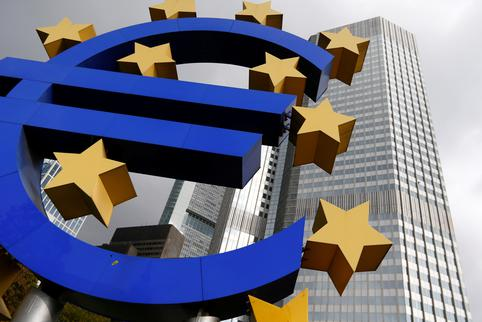 FILE PHOTO: A euro logo sculpture stands in front the headquarters of the European Central Bank  in Frankfurt