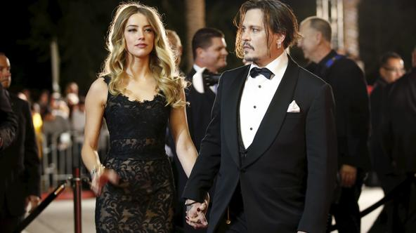 Desert Palm Achievement Award recipient actor Johnny Depp and wife actress Amber Heard pose at the 27th Annual Palm Springs International Film Festival Awards Gala in Palm Springs, California, January 2, 2016. REUTERS/Danny Moloshok/Files