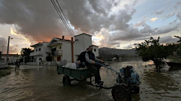 \'Villagers drive their small tractor through a neighborhood flooded by water from the Neretva river in Croatia\'s town of Metkovic some 550 kilometers south of capital Zagreb December 2, 2010. Heavy