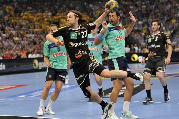 \'Ivan Cupic (C) from the team Rhein-Neckar Loewen (Mannheim, Germany) vies against players of FC Barcelona Borges (Spain) during their EHF Final Four Handball Champions League semi-final match on May