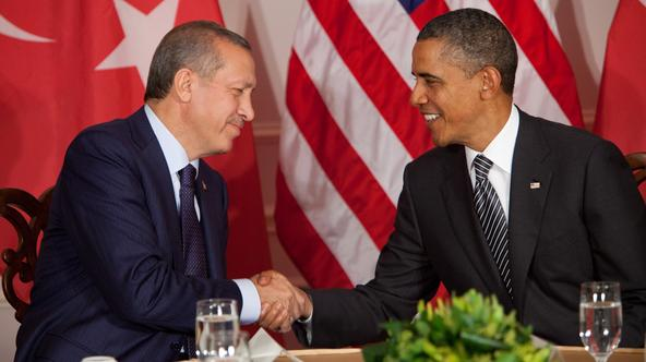 United States President Barack Obama, right, holds a bilateral meeting with Prime Minister Recep Tayyip Erdogan of Turkey, left, and shakes hands at the United Nations General Assembly in New York, New York, on Tuesday, September 20, 2011. Photo: Allan Ta