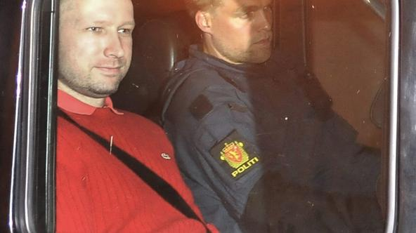 \'Norwegian Anders Behring Breivik (L), the man accused of a killing spree and bomb attack in Norway, sits in the rear of a vehicle as he is transported in a police convoy as he is leaving the courtho