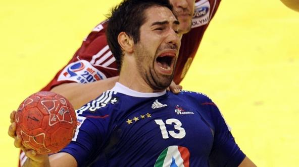 'French Nikola Karabatic (L) grimaces next to Hungarian Balazs Laluska (R) during the Men\'s EHF Euro 2012 Handball Championship match France vs Hungary at the sports hall in Novi Sad on January 20, 2