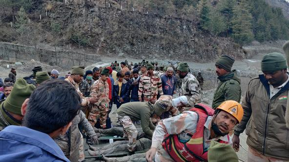 Members of Indo-Tibetan Border Police tend to people rescued after a Himalayan glacier broke and swept away a small hydroelectric dam, in Chormi
