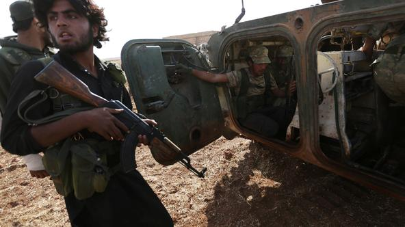 Rebel fighters ride a military vehicle on the outskirts of Syria Democratic Forces (SDF) controlled Tell Rifaat town, northern Aleppo province, Syria October 22, 2016. Picture taken October 22, 2016. REUTERS/Khalil Ashawi