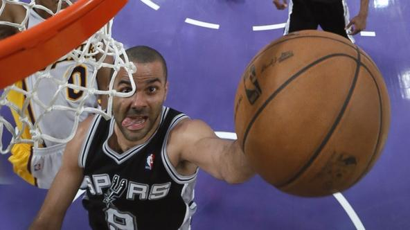 'San Antonio Spurs Tony Parker (R) goes up to score against Los Angeles Lakers Andrew Goudelock during Game 4 of their NBA Western Conference Quarterfinals basketball playoff series in Los Angeles, Ap
