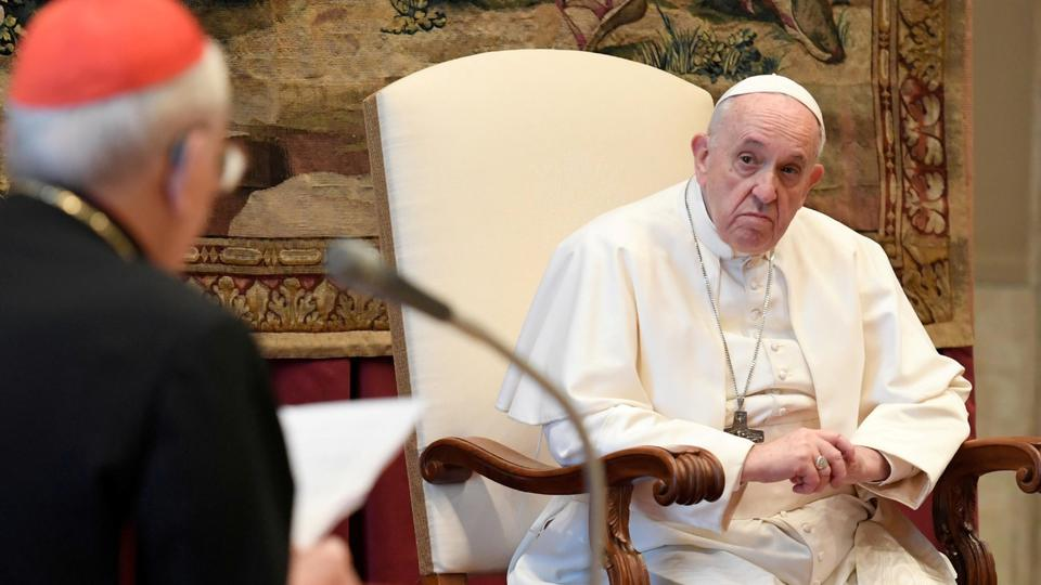 FILE PHOTO: Pope Francis listens during the traditional greetings to the Roman Curia at the Vatican