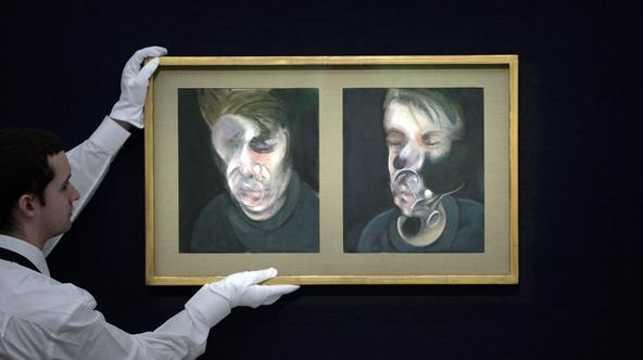 Contemporary art sales at Sotheby's - LondonA Sotheby's employee hangs Francis Bacon's Two Studies for a Self-Portrait, 1977 (estimated at 13-18 million) ahead of the preview facility for the forthcoming contemporary art sales at Sotheby's auction house,
