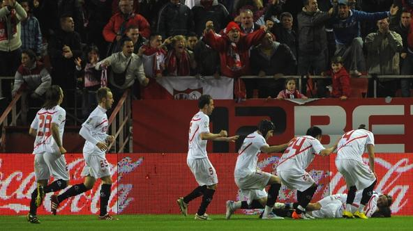 'Sevilla\'s players celebrate after scoring during their Liga football match Sevilla vs FC Barcelona at Ramon Sanchez Pizjuan stadium on March 13, 2011, in Sevilla.    AFP PHOTO/ JORGE GUERRERO '
