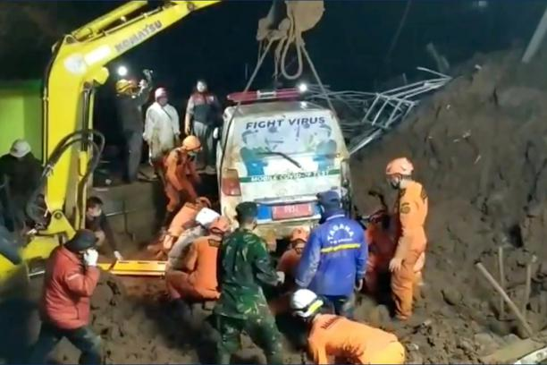 An ambulance is being lifted after it was buried in a landslide in Sumedang, West Java, Indonesia