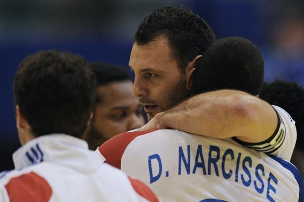 'French captain Jerome Fernandez (C) is congratuled by Daniel Narcisse after their team won against Slovenia during the men\'s EHF Euro 2012 Handball Championship match between France and Slovenia at