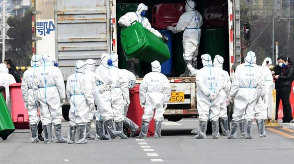 Workers in protective suits take part in the disinfection of Huanan seafood market, where the novel coronavirus is believed to have first surfaced, in Wuhan