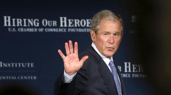 Former U.S.  President George W. Bush waves as he departs the stage after speaking at the U.S. Chamber of Commerce Mission Transition summit, to discuss creating employment opportunities for post-9/11 veterans and military families in Washington June 24,