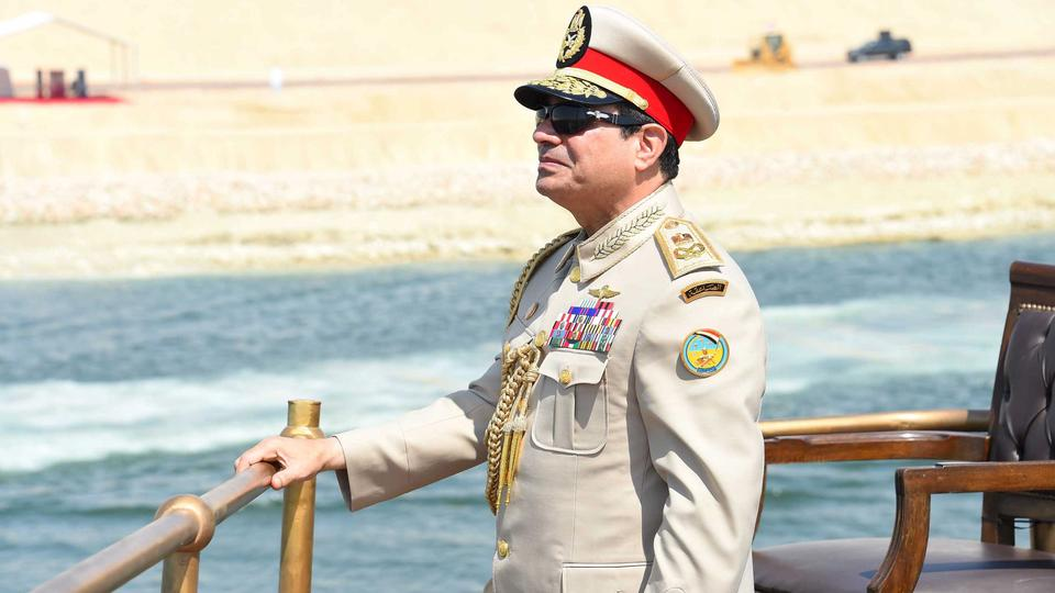 Egyptian President Abdel Fattah al-Sisi stands in boat on the Suez Canal as he attends the celebration of an extension of the Suez Canal in Ismailia, Egypt, August 6, 2015. Egypt will open an expansion to the Suez Canal to great fanfare on Thursday, the c