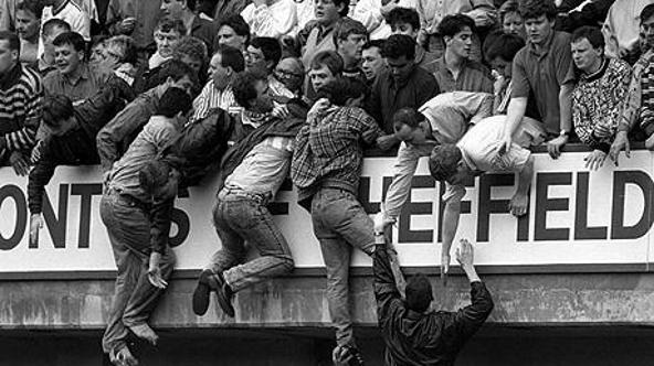 'SAFRICA Stampede/Hillsborough 3...File photo dated 15/4/89 of Liverpool fans trying to escape severe overcrowding at the FA Cup semi-final football match between Liverpool and Nottingham Forest at Hi