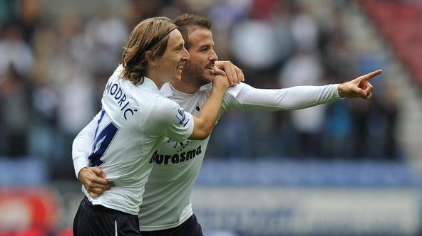 'Tottenham Hotspur\'s Rafael van der Vaart is congratulated by Tottenham Hotspur\'s Luka Modric after scoring his side\'s first goal during the Barclays Premier League match at the DW Stadium, Wigan.